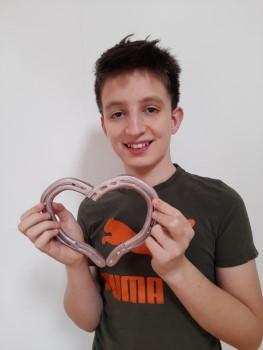 Josh hold rose gold horseshoe heart