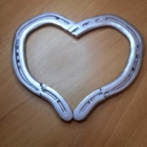 I made this heart from some old rusty horseshoes that I cleaned up and welded together